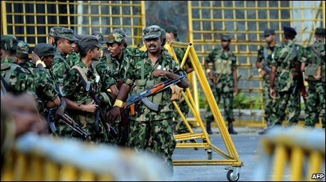 Soldiers gather outside Colombo's Cinnamon Lakeside hotel