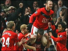 Wayne Rooney is congratulated by his team mates