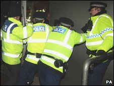 Police officers trying to close a door at Old Trafforcd as fans tried to break out of the ground