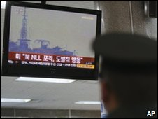 A South Korean marine soldier at Incheon port, west of Seoul, watches a TV screen reporting about North Korea firing artillery near the disputed sea border
