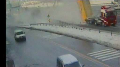 The lorry crashing into the bridge