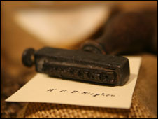 First Mate's name stamp, recovered by divers and on show at Oriel Môn