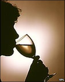 silhouette of man drinking wine
