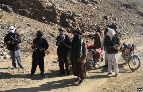 Afghan Taliban fighters display their weapons in Ghazni province, 23 January