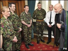 President Hamid Karzai speaks to soldiers who have served in Afghanistan