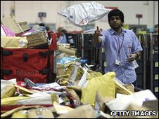 A worker in a sorting office