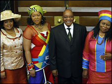 Jacob Zuma standing with his three wives
