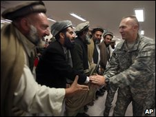 A US army official greets tribal leaders in Nangarhar province