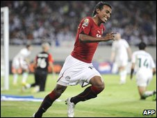 Mohamed Abdelshafi of Egypt celebrates after scoring his team's third goal against Algeria 