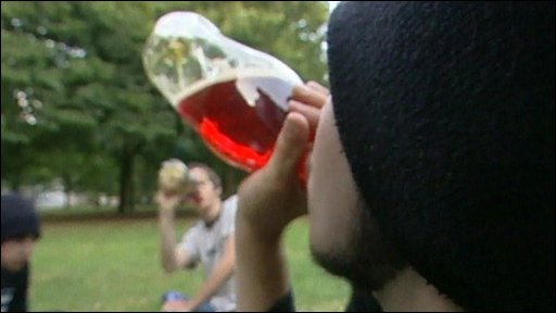 A youth drinking alcohol