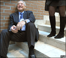 George Soros on stairs at the congress centre in Davos