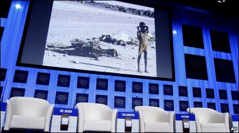 A child shown on a screen before a session on climate change at Davos on 29 January 2010