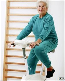 an elderly woman on an exercise bike