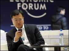 Man checking phone at Davos