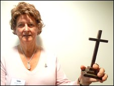 Miranda Ponsonby with her mother's wooden cross