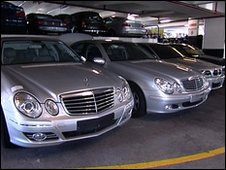 Row of silver Mercedes Benz cars that had been cloned