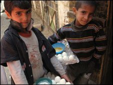 Yemeni boys selling hard-boiled eggs on the street(Photo by Hugh Sykes)