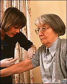 elderly woman being given an injection