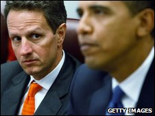 Timothy Geithner in focus behind President Obama