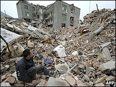 Man sits amid rubble of houses destroyed by an earthquake (Image: AFP)