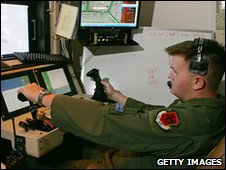 US Air Force airman operates the sensor control station of an MQ-9 Reaper unmanned plane