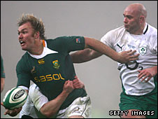 Schalk Burger (left) eludes the challenge of Ireland's John Hayes