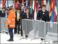 Japanese delegation walks through the snow