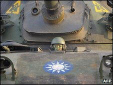 Taiwanese soldier in a Taiwan-made CM-11 tank
