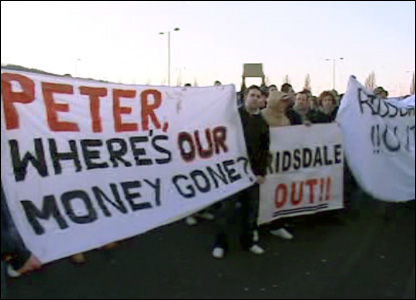 Cardiff City fans protesting against chairman Peter Ridsdale
