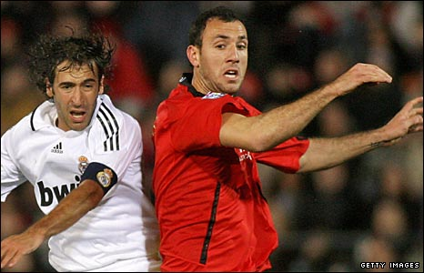 Ivan Ramis (right) challenges Raul of Real Madrid