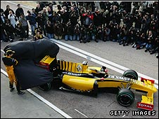 Vitaly Petrov (left) and Robert Kubica (right) unveil Renault's new R30 car at the launch in Valencia