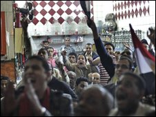 Egyptian soccer fans watching the Ghana-Egypt game on television in Cairo