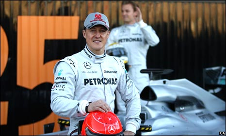 Michael Schumacher poses with the new Mercedes