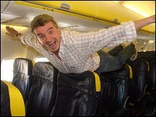 Michael O'Leary pretending to fly on one of his planes