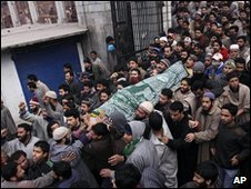 Kashmiri Muslims shout anti-India slogans as they carry the teenage boy's body in a funeral procession through Srinagar, Indian-administered Kashmir, 1 Feb 2010