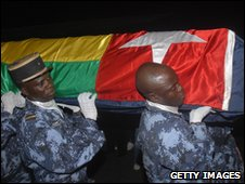 Togolese police officers  carry the coffin of one of the victims of the attack on the Togo team bus
