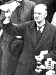 British PM Neville Chamberlain in 1938 waving a letter signed by Adolf Hilter (Image: PA)