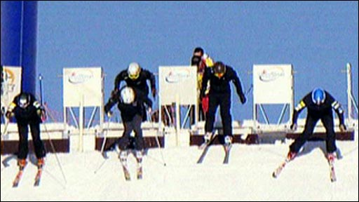 Ski cross racers in action