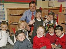 Philip Bujak with children at a Montessori school