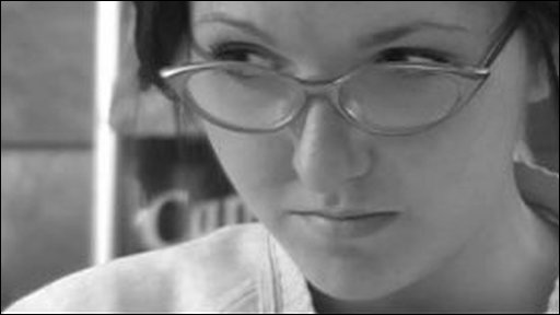 Black and white image of woman wearing glasses