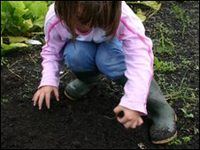 Young girl planting seeds