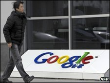 Man walks past Google sign in China