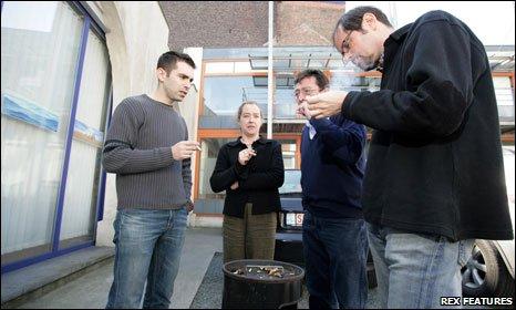 Huddle of street smokers