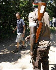 An armed guard at teh gates of a farm in Chegutu, file image