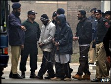 Pakistani police escort US militant suspects as they depart an anti-terrorist court following a hearing in Sargodha on January 18, 2010