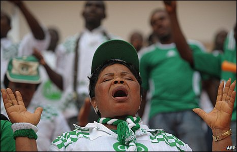 Supporters of the Nigerian National football team, The Super eagles, pray a few moments before their Africa Cup of Nations semi-final football match against Ghana at the 11 November stadium in Luanda on 28 January 2010
