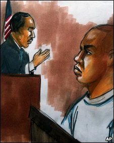 courtroom drawing shows Umar Farouk Abdulmutallab, 23, (R) charged with attempting to blow up a Detroit-bound US airliner, at his hearing in Detroit federal court on 8 January 2010