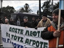 Protesting farmers march in central Athens on January 25, 2010. Greek farmers, who have blocked highways and frontier posts for a week to demand higher product prices