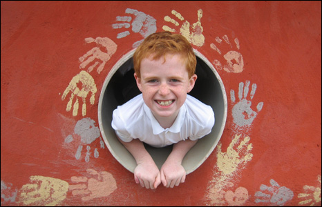 A pupil enjoys playing in the eco shelter at Edwardsville primary school