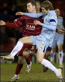 Aberdeen's Steven MacLean is thwarted by Darren Barr
